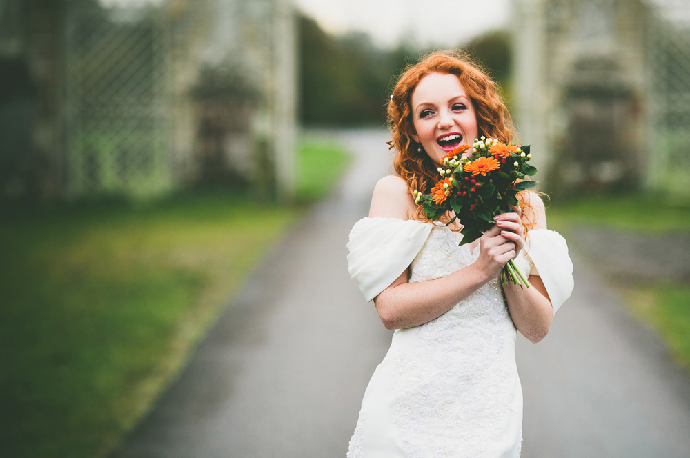 Bridal model Ivory Flame laughing in wedding dress by photographer Aaron Storry