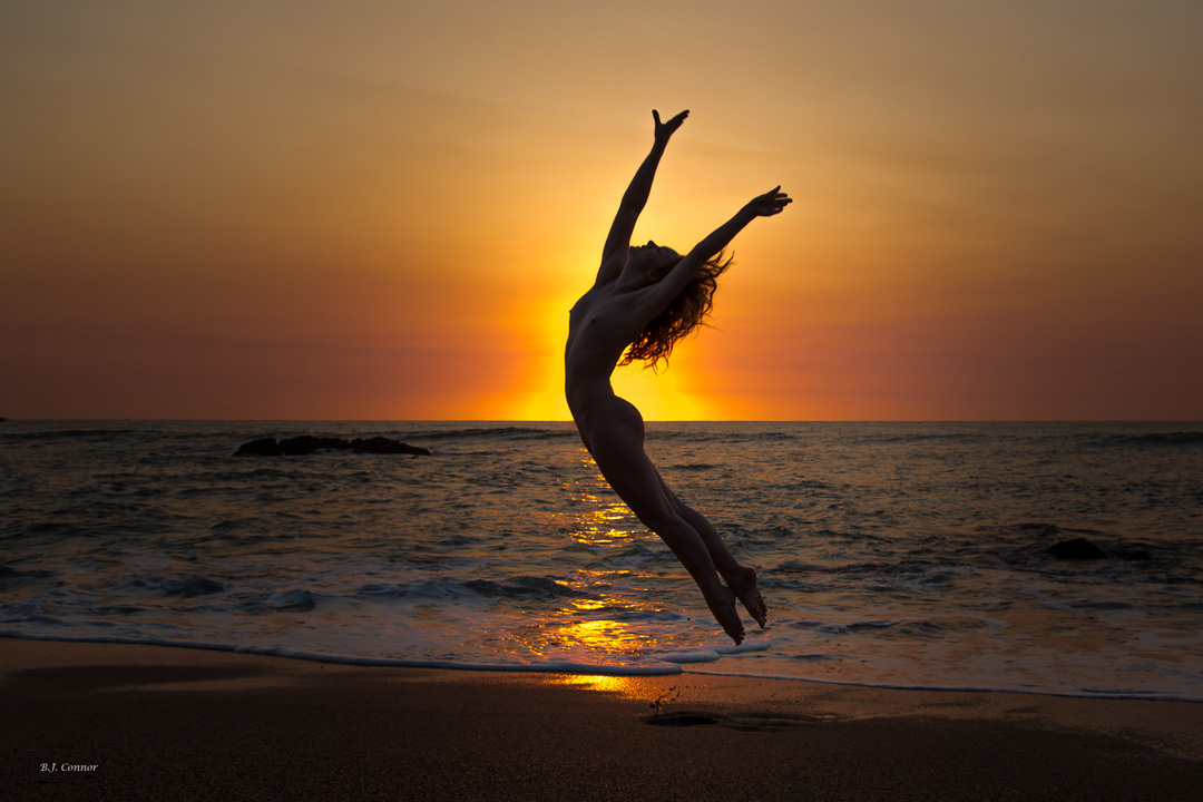 Art Nude Model Ivory Flame silhouette jumping at sunrise by photographer Brian Connor in Australia