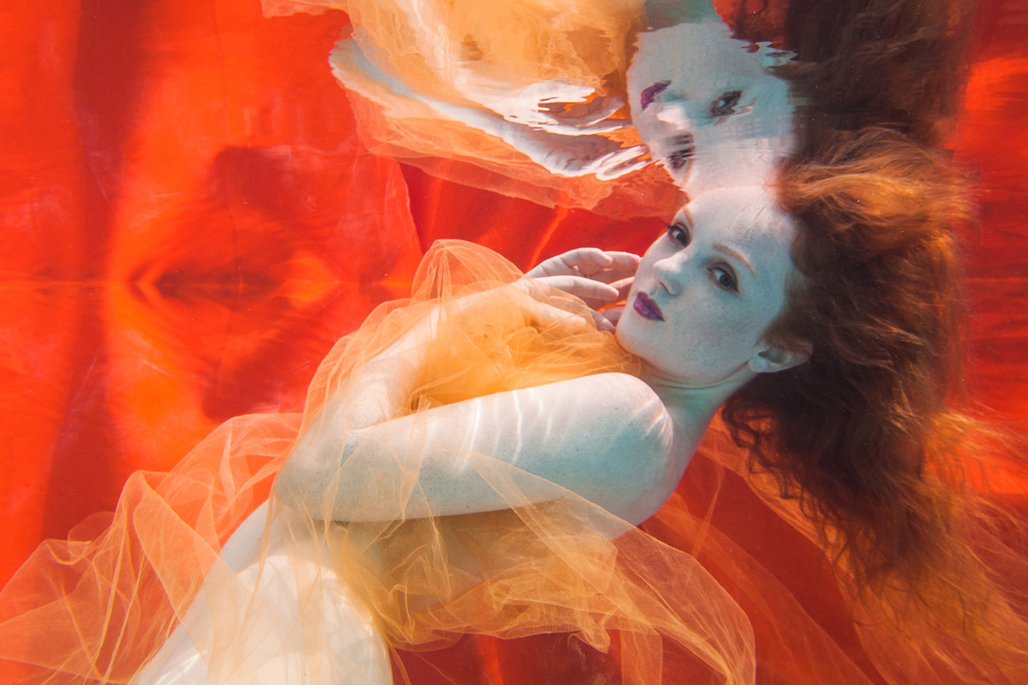 vory Flame redhead model underwater by photographer Chris Meredith