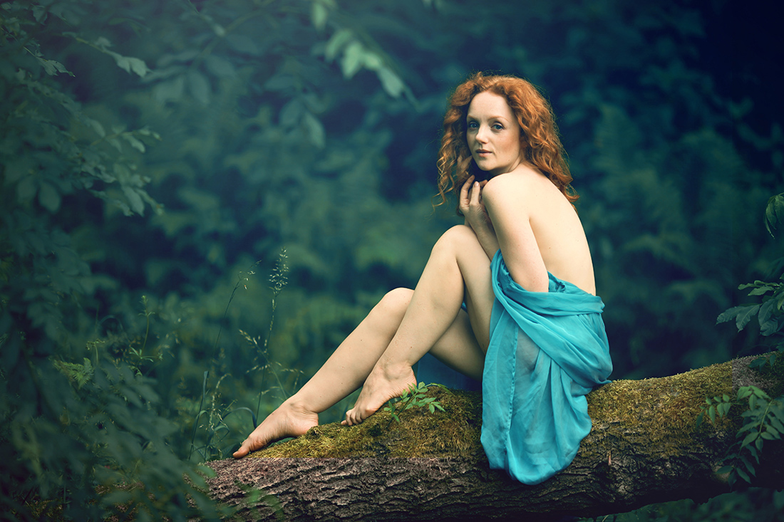 Pre-raphaelite redhead model with pale skin Ivory Flame photographed by Derek Brewster