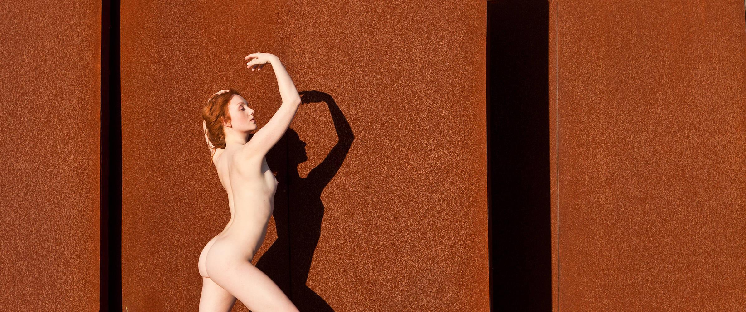 Artistic Figure Nude model Ivory Flame against rust by Francisca da Silva in Portugal