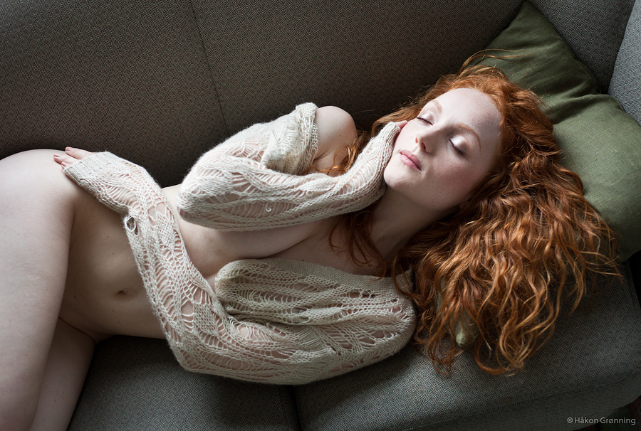 Red-haired model IVORY FLAME sleeping by Norwegian photographer Hakon Gronning