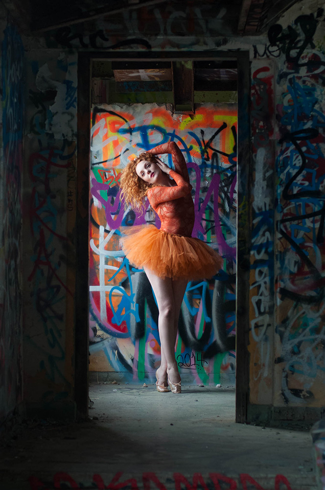 Redhead model with pale skin IVORY FLAME in ballet tutu graffiti urbex photoshoot with Rebecca Knowles Photography