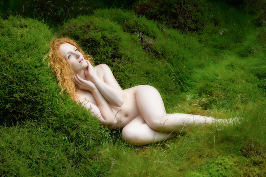 Ivory Flame nude model nymph in moss by John McNairn