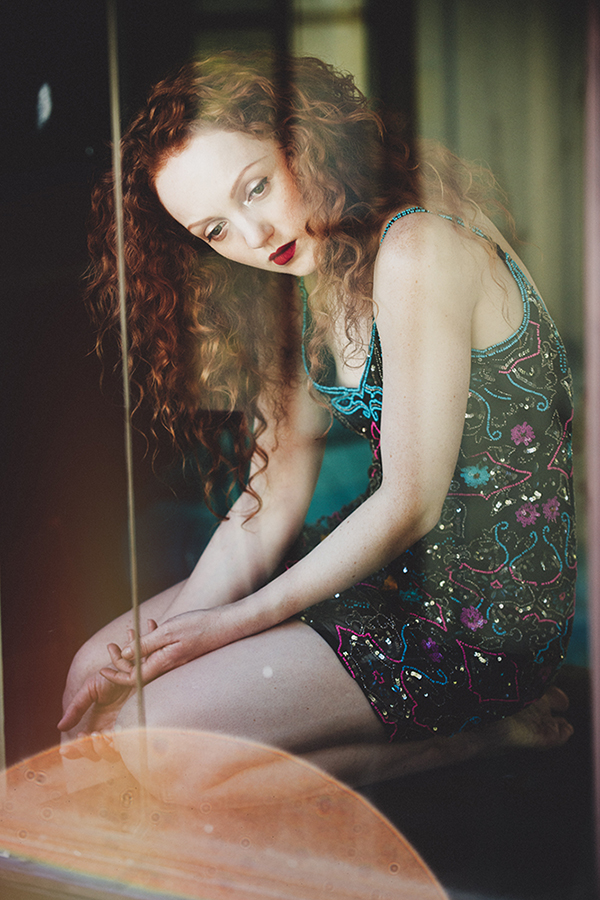 Red-haired model Ivory Flame portrait fashion by photographer Mike Stacey