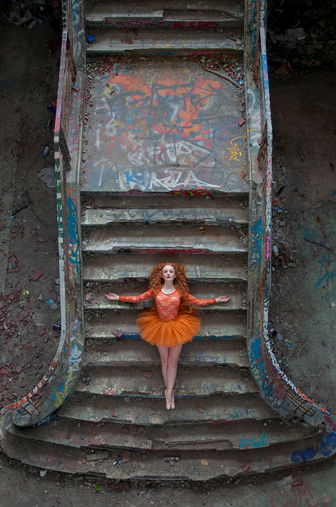 Red-haired model with pale skin IVORY FLAME in ballet tutu graffiti urbex photoshoot with Rebecca Knowles Photography