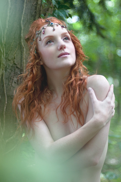 Redhead pre-raphaelite model Ivory Flame nymph in woodland, by Rebecca Knowles Photopgraphy