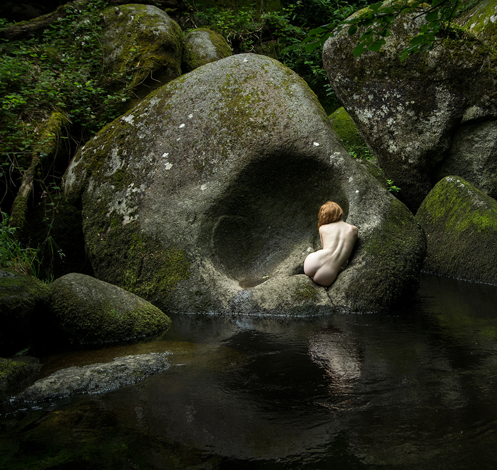 fine art nude model IVORY FLAME in rocks landscape by photographer Tim Pile