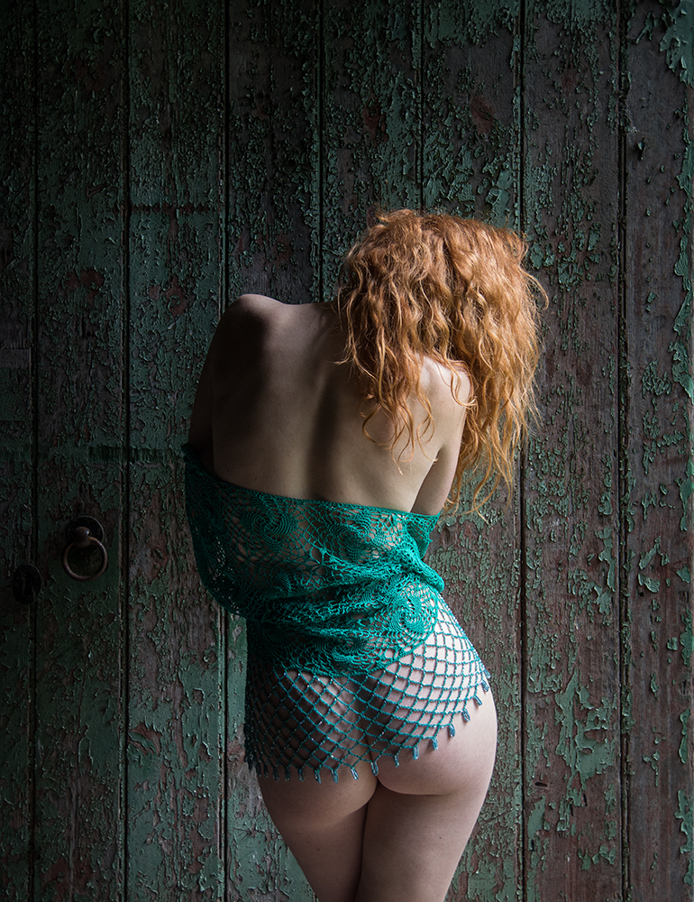 Ivory Flame nude backchat against textured door by Tim Pile