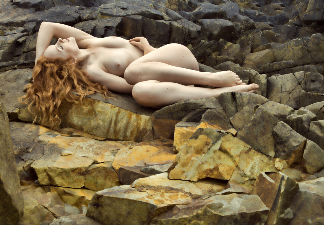 IVORY FLAME nude model on rocks in France by Tim Pile