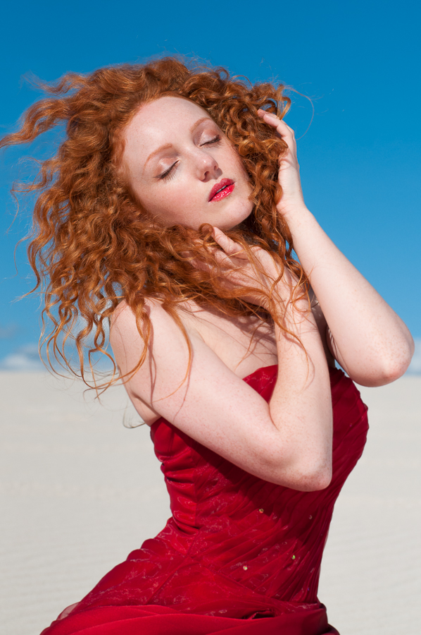 Redhead model Ivory Flame in red dress by Rebecca Knowles photography